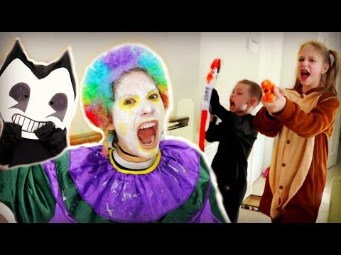 Crazy Clown Attack on Halloween! FREAKY MONSTERS SCARES BENDY SuperHeroKids Nerf Attack