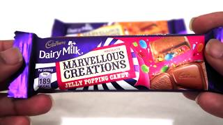 Snakinworld unwrapping and trying the famous cadburys diary milk marvellous creations jelly popping candy and cookie gummy crunch Its a fascinating and entertaining chocolate to eat. In diary milk jelly popping candy there is a legit popping candies hidden in the chocolate which gives a popping sensation on our tongue while the chocolate melts. Cookie gummy crunch of diary milk also has a cookie bits in-between the chocolate which is very unique. Both of the diary milk chocolates are very unique flavour