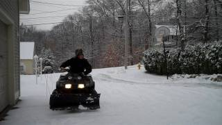 9. Kawasaki prarie 360 4x4 plowing snow
