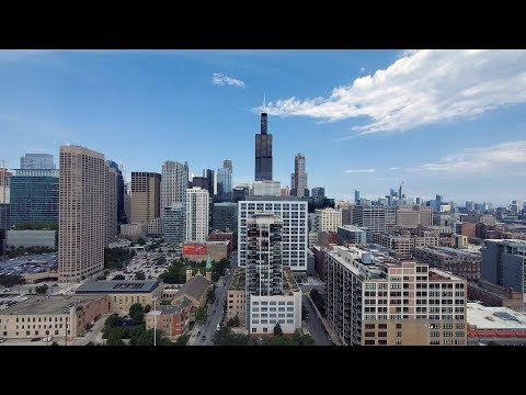 A skyline-view one-bedroom at the full-amenity Arkadia West Loop