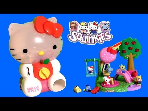 toys - Disney Collector presents Hello Kitty Dispenser. It's huge large size HelloKitty with 8 exclusive Squinkies toy-surprize inside. Magically open the center of Kitty's bow and fill the dispenser...