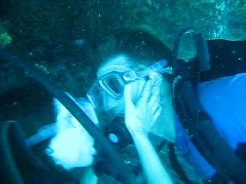 Robert and Laura kissing underwater in Crystal Cove- Bali, Indonesia