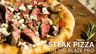 Take pizza night to the next level with this steak pizza recipe!  We start off by searing a Ribeye, and char grilling some onions on the Blaze Pro to top the pizza.  Next, I show you how to make a quick red wine pizza sauce to compliment the steak.  We top the pizza with some baby bella mushrooms, cherry tomatoes, grilled onion, fresh mozzarella cheese & rosemary, then we grill it on the Blaze stainless steel cooking plate for a crispy crust!  Printable Recipe: https://www.bbqguys.com/bbq-learning-center-recipes-steak-pizza-on-the-blaze-professional-grillShop Blaze Pro: https://www.bbqguys.com/blaze-outdoor-products/professional-34-inch-built-in-natural-gas-grill-with-rear-infrared-burner-blz-3pro-ngBlaze Stainless Steel Cooking Plate: https://www.bbqguys.com/blaze-outdoor-products/15-inch-4-in-1-stainless-steel-cooking-plateFull Recipe: Toppings:Ribeye Steak                     1 ea.Red Onion                         1 ea.Baby Bella Mushrooms      enough for toppingFresh Mozzarella (diced)    enough for toppingBlue Cheese Crumbles       enough for toppingCherry Tomatoes (halved)   enough for toppingRosemary (chopped)          1.5 tsp.For Red Wine Sauce:Salted Butter                                 3 T.Diced Garlic                                  3 clovesGrilled Red Onion (diced)             3 onion ringsCabernet Sauvignon                       ⅔ cup    Pizza Dough:Makes 2 dough balls1/2 cup mineral water1 1/2 tsp. yeast2 tsp. honey2 T. olive oil1 1/2 cups bread flour2 tsp. coarse saltIf making dough from scratch -- Whisk warm mineral water and yeast together in a mixing bowl, and follow that by mixing in the honey and olive oil.- Allow yeast mixture to rest for 10 minutes so that the yeast activates.- In a separate mixing bowl, blend flour and salt together, and form a well in the center of the mixture.- After yeast mixture has rested 10 minutes, pour into the well in the center of the flour mixture. - Gradually spin in the flour mixture so that it combines with th