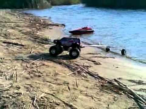 RC crawler launching boat on trailer