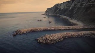 some flights near the fisherman's caves under Ancona city, in Italy music: Procession of the king from incompetech.com.