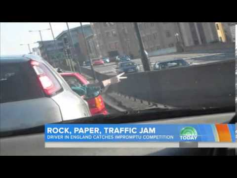Playing Rock Paper Scissors in a Traffic Jam