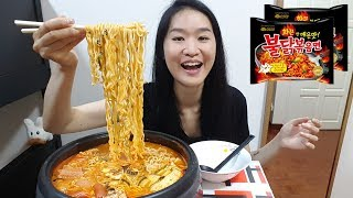 """Cooking and eating Korean Army Stew with Fire Noodles!Ingredients:- King oyster mushrooms- Enoki mushrooms- Shitake mushrooms- Tofu- Kimchi- Baked beans- Spam- Sausages- Spring onions- Samyang Fire Noodles- Cheddar cheese slices- Campbell's Chicken StockSupport my channel on Patreonhttps://www.patreon.com/peggieneoFollow me on Facebookhttps://www.facebook.com/peggieeatsNoodles Mukbang ShowsCheesy Fire Noodles https://youtu.be/w8Z3-e5iccIBlack Bean Noodles https://youtu.be/yRdw2wnaEqsIndomie Mi Goreng Noodles https://youtu.be/CRK3hhmAgtMFood ChallengesMassive English Breakfast in UK https://youtu.be/3m62-_VtzzEPho Noodles Challenge in UK https://youtu.be/7DOPI6tSy3M4 Footlongs Subway Challenge https://youtu.be/cDPHO3l6nyQFast Food MukbangsJollibee Fried Chicken https://youtu.be/vNjgW-sOo3EKFC Kentucky Fried Chicken https://youtu.be/vNjgW-sOo3EPizza Hut Triple Treat Box https://youtu.be/1rpUWL0s5bQSweet Mukbang Shows10 Flavors Cheesecake https://youtu.be/fIp1iRjblfwKrispy Kreme Doughnuts https://youtu.be/dbCyJP_n5gkParis Baguette Mango & Chocolate Cake https://youtu.be/rGG5dIEm5YEMusic""""Funin and Sunin"""" Kevin MacLeod (incompetech.com)Licensed under Creative Commons: By Attribution 3.0 Licensehttp://creativecommons.org/licenses/by/3.0/"""