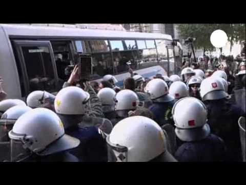 Greek workers break into labour minister's office | Greek police arrested up to 30 protesters