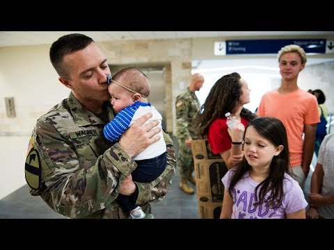 Returning Soldiers Hold Their Babies For The First Time