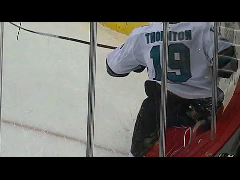 Video: Oshie gets head smashed in by Thornton's behind, leaves game