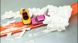 Cars jumping into the foam Video for Kids