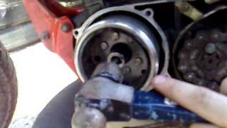 6. Remove flywheel/stator without special tools.