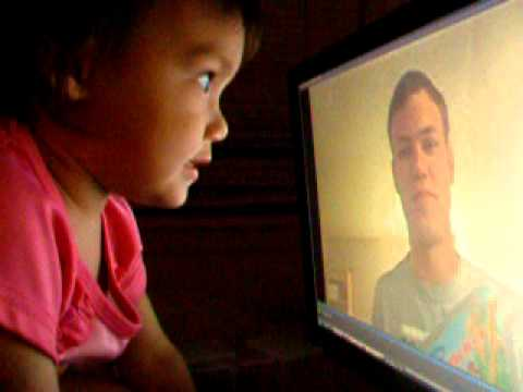 2 Year Old Watching Video Of Military Dad Reading Story