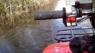 8. 2009 polaris trail boss 330.  Flooded trail riding