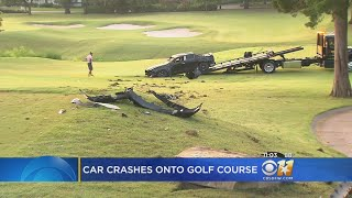 Police say a car flipped over several times and crashed onto a Dallas golf course Saturday morning.