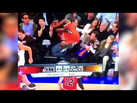 11 - Father reacts quickly and saves his daughter from harm when a Bulls' player dives into the stands. IN THE PRESS: http://www.tmz.com/2013/12/12/kenny-meiselas-chicago-bulls-tony-snell-dive-bomb-he...