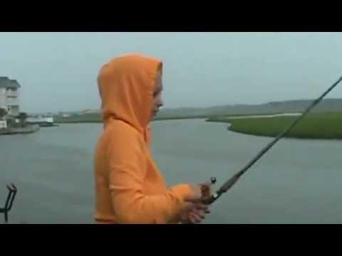 Huge shark attacks fish from a girls fishing line in South Carolina.