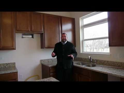 Touring a new home at Ashford Place in Plainfield