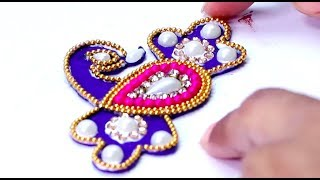 How to make awesome designer peacock rakhi at home, Raksha Bandhan craft idea. Homemade rakhi for brothers. DIY Rakhi making tutorial for girls. For more amazing DIY Craft Ideas, visit http://www.craftinghours.com Connect us on Facebook: https://www.facebook.com/CraftingHours/Follow us on Twitter: https://twitter.com/craftinghours