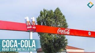 Coca-cola road sign installation