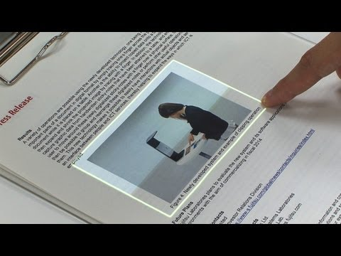 Diginfonews - Real world touchscreen interface for interactive documents and books (http://www.diginfo.tv/v/13-0025-r-en.php) 11/4/2013 Fujitsu Laboratories, Fujitsu Next-...