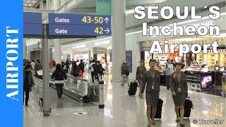 """We are at Incheon Airport- Korean: 인천국제공항 -  in Seoul, South Korea. This is a tour of South Korea´s biggest and busiest Airport, Incheon Airport or Seoul Airport. Incheon Airport is rated among the best airports in the world and has one multiple awards over the year to back that up. Awards include Skytrax Awards and  Airports Council International has given it a  """"best airport worldwide"""" award.We have just arrived at the airport on a Korean Airways Flight from Ho Chi Minh City and have another connection flight with Korean Airways to Amsterdam. That means that we are going to be in transit at this Korean Airport´s main departure terminal for at least six hours. This inside Incheon Airport tour aims to show you what one of the world´s best airports has to offer passengers arriving, departing or who are having connection flights to or from this Airport close to South Korea's capital city Seoul. The video includes our disembarkation from the aircraft and begins after we have passed the security control area and arrive in the main departure hall. This video shows the viewer what Duty Free Shops and services, restaurants, bars and other services this Korean Airport has to offer. We also take the time to do some plane spotting out of this airports huge panoramic windows, where we see heavy aircraft such as a Korean Air Boeing 747, an Air France Boeing 777 an Asiana Airlines Boeing 777 and an Asian Airlines Airbus A380, so watch out for that part of this Airport tour video. This airport tour is rounded off with our visit to the """"Sky Hub Lounge"""" . The Sky Hub Lounge is available to all passengers including First Class Passengers, Business Class Passengers and Economy Class Passengers. As we were flying Economy Class we had to pay for access to this airport lounge. The """"Sky Hub Lounge"""" was comfortable  and the price included snacks, hot and cold light meals, hot and cold beverages and alcoholic beverages. The lounge also had two complimentary computers with internet access f"""