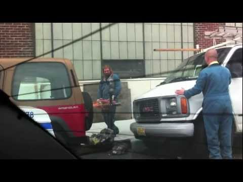 Crazy Guy Cuts Off Parking Meter with Saw