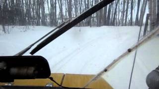 6. Going for a ride on(in) a 1978 Ski Doo Elite