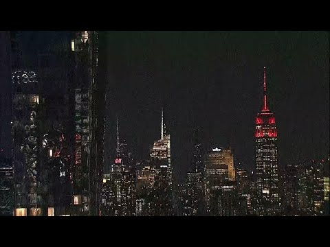 Empire State Building pulses red for virus victims