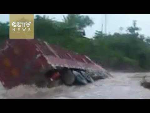 Brave or foolhardy? Video of Chinese truck driver engulfed by floods goes VIRAL