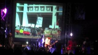 """John Leemans & the Lazy Late Boys play their new song """"Land Rights"""" at a concert celebrating Gurindji Freedom Day on August 26 2011. Images projected on stage are from the campaigns against the NT Intervention and the proposed NT nuclear waste dump.This Freedom Day marked 45 years since the walk-off from Wave Hill station, led by Vincent Lingiari, which helped catalyse the modern Land Rights movement. Many Gurindji are taking up the fight once again. John Leemans is a spokesperson for the Intervention Rollback Action Group."""
