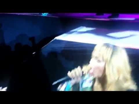 Rihanna hits fan with her microphone