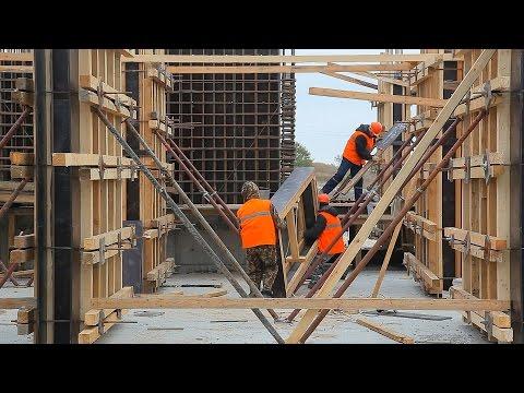 Репортаж остроительстве дома для работниковСЗ «Залив»