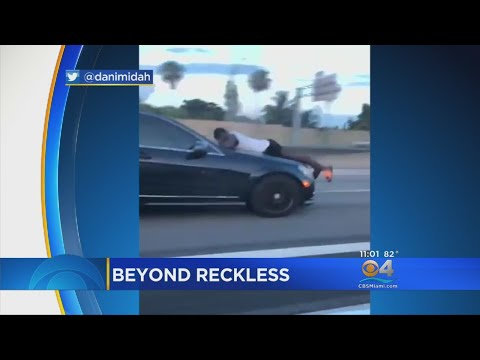 Video Video Captures Man Riding Hood Of Car On I-95 download in MP3, 3GP, MP4, WEBM, AVI, FLV January 2017