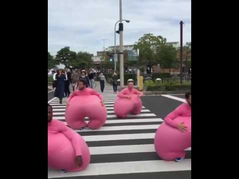 Guys in pink suits bouncing