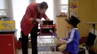 Carl performs magic for birthday boy