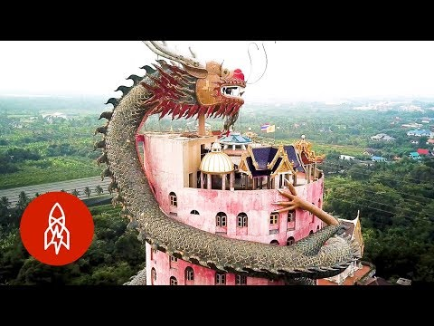 A Giant Buddha Temple In Thailand With A 17Story Dragon Wrapped Around