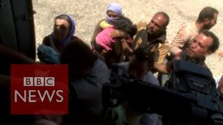 Desperate Yazidis Cling On To Aid Flight