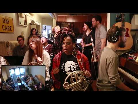 "100 musicians all in one apartment play ""Wake Up"" by Arcade Fire"
