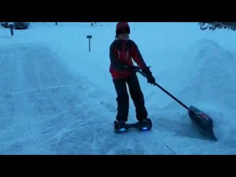 Kid Plows Driveway With Hoverboard And Snow