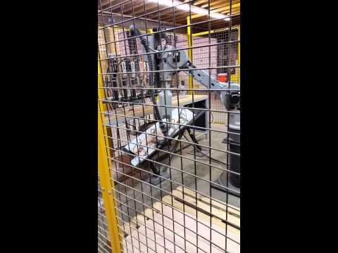 Motoman Robot At Loudoun Stairs, Inc - Drilling Holes In Risers