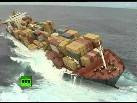 tanker - A salvage crew has finally managed to board a cargo ship that has spilled hundreds of tons of oil since striking a reef off the coast of New Zealand. Video f...