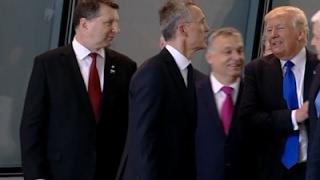 Raw: Trump Pushes Past Montenegro PM at NATO