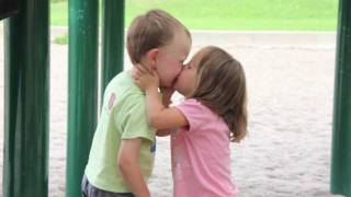 Cute kissing moment of a 3 year old getting his first kiss. Boys and Girls are so funny sometimes and they sure do and say the darnedest things. While the little ...