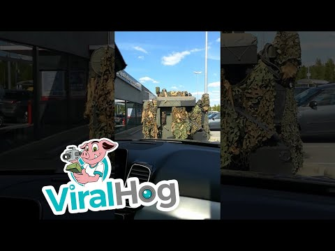 A Belgian Military Tank Drives Through a Fast Food Restaurant DriveThru To Order