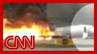 Plane catches fire in emergency landing