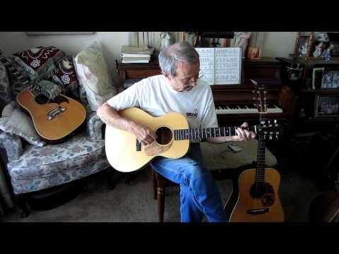 John Arnold Playing his Maple Guitar