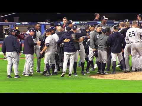 New York Yankees celebrate on the field and locker room after beating the Indians in ALDS