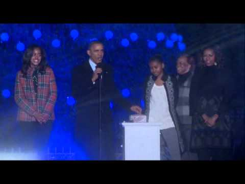 national - President Barack Obama has thrown the switch, bathing the National Christmas Tree in lights and giving an otherwise dreary day in the nation's capital a fest...