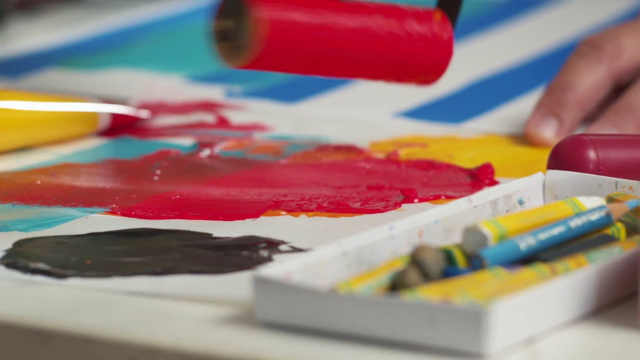 An illustration of red paint being rolled onto a canvas.